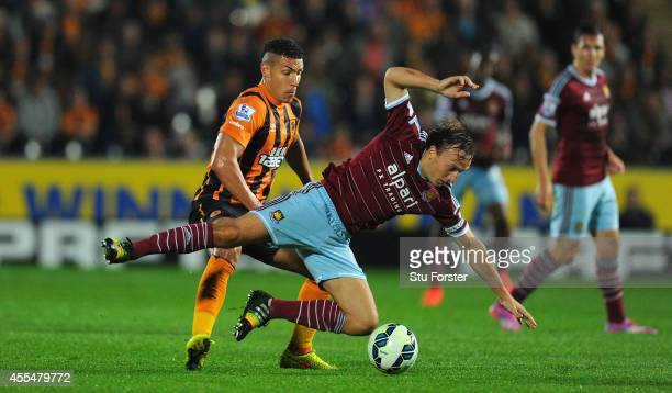 Hull player Jake Livermore challenges Mark Noble of West Ham during the Barclays Premier League match between Hull City and West Ham United at KC...