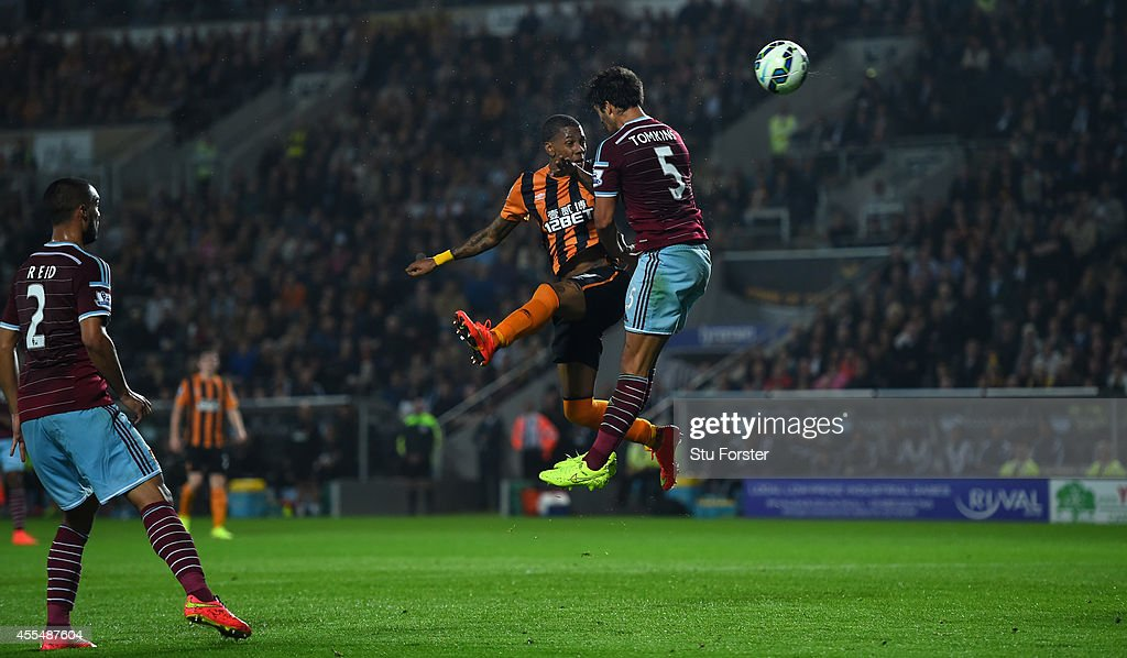 Hull striker Abel Hernandez beats West Ham defender James Tomkins (r) to score the first goal during the Barclays Premier League match between Hull City and West Ham United at KC Stadium on September 15, 2014 in Hull, England.