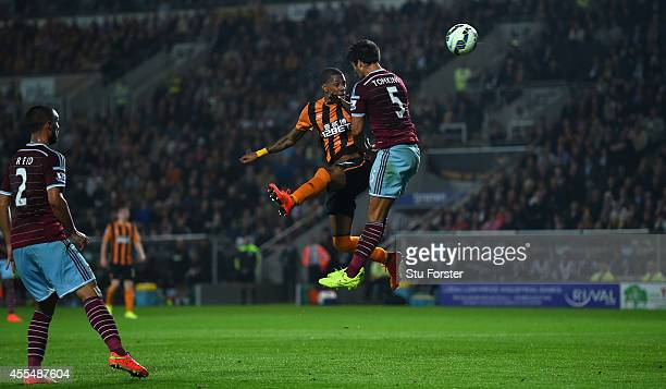 Hull striker Abel Hernandez beats West Ham defender James Tomkins to score the first goal during the Barclays Premier League match between Hull City...