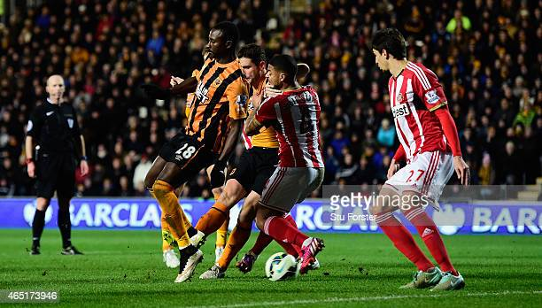 Hull striker Dame N' Doye flicks in the first goal during the Barclays Premier League match between Hull City and Sunderland at KC Stadium on March 3...