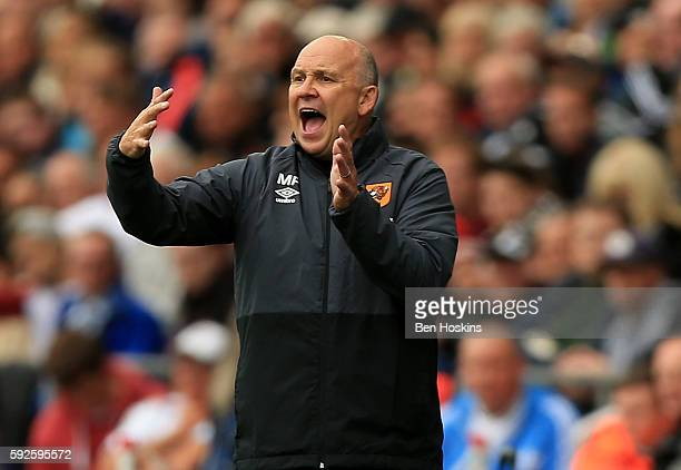 Hull's caretaker manager Mike Phelan gives instructions during the Premier League match between Swansea City and Hull City at Liberty Stadium on...