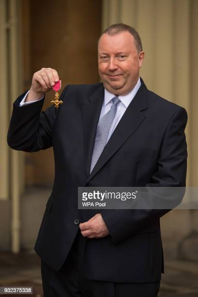 Hull's city culture manager Jonathan Pywell poses with his OBE medal awarded by the Prince of Wales following an investiture ceremony at Buckingham...