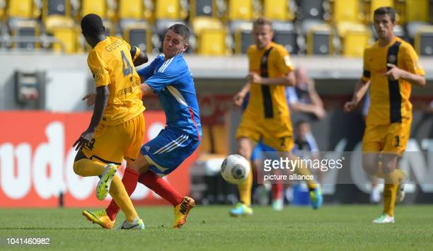 Hull's Robbie Brady vies for the ball with Dresden's Cheikh Gueye during the friendly match between SGDynamoDresden and Hull City AFC at glueckgas...