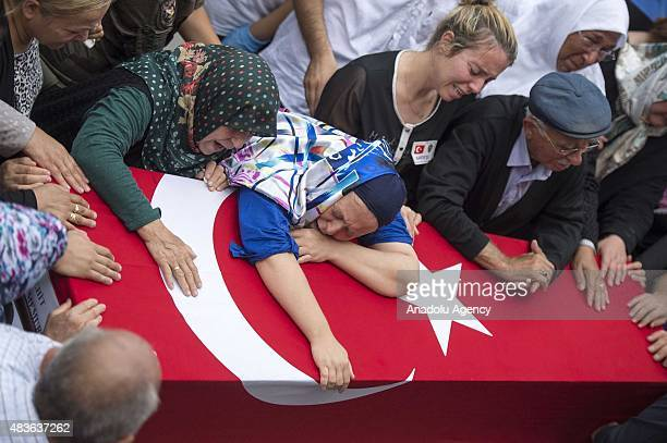 Hulya Aydin mother of Turkish police Sahin Polat Aydin who was killed in a terrorist attack in Sirnak province mourns over his son's coffin during a...