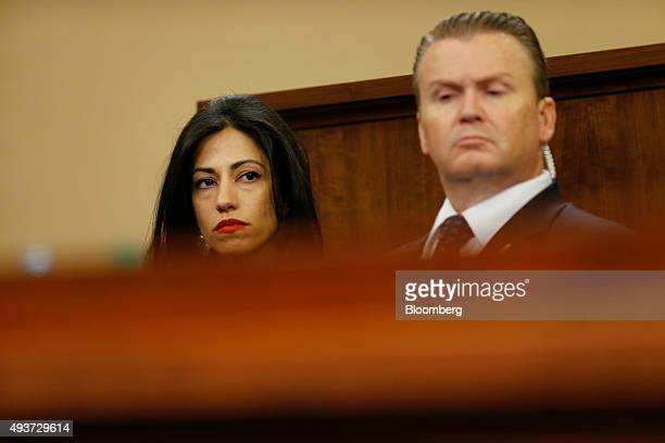 Huma Abedin a longtime aide to Hillary Clinton former US secretary of state and 2016 Democratic presidential candidate left listens during a House...