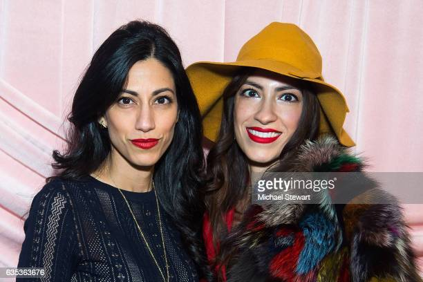 Huma Abedin and Heba Abedin attend the Alice Olivia by Stacey Bendet presentation during February 2017 New York Fashion Week at Highline Stages on...