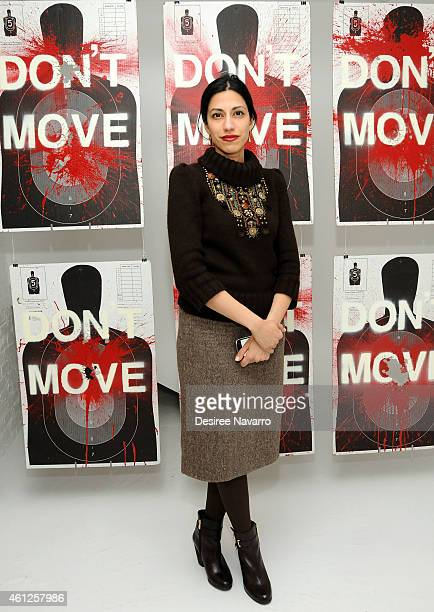 Huma Abedin attends Ryan Piers Williams' Monsters And Landscapes Exhibition Opening Reception at The Garfield Building on January 9 2015 in New York...