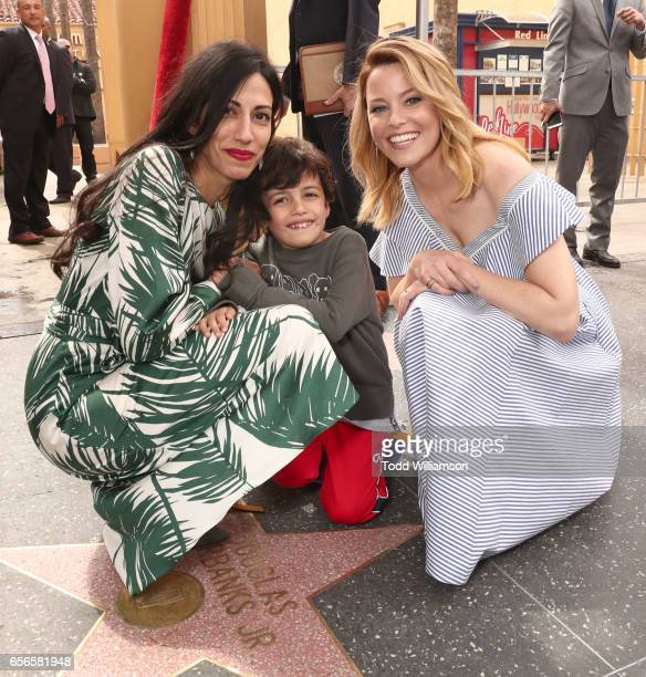 Huma Abedin Jordan Weiner and Elizabeth Banks attend a Star Ceremony on The Hollywood Walk Of Fame Honoring Haim Saban on March 22 2017 in Hollywood...