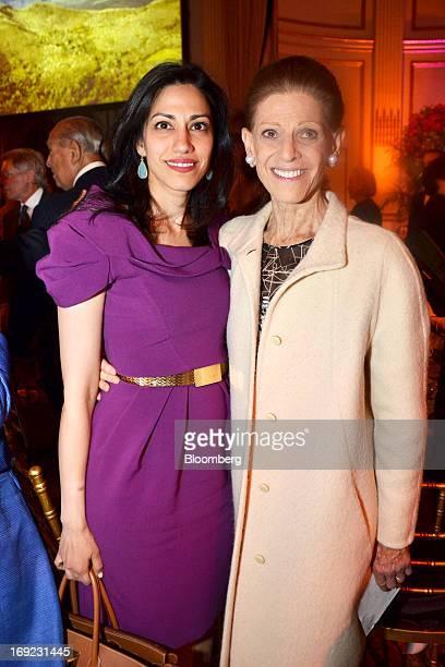 Huma Abedin senior adviser to former US Secretary of State Hillary Clinton left and Annette de la Renta wife of designer Oscar de la Renta attend...