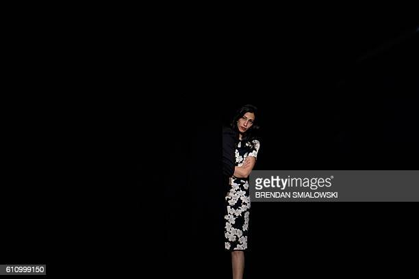Huma Abedin waits for an event with Democratic presidential nominee Hillary Clinton at University of New Hampshire September 28 2016 in Durham New...