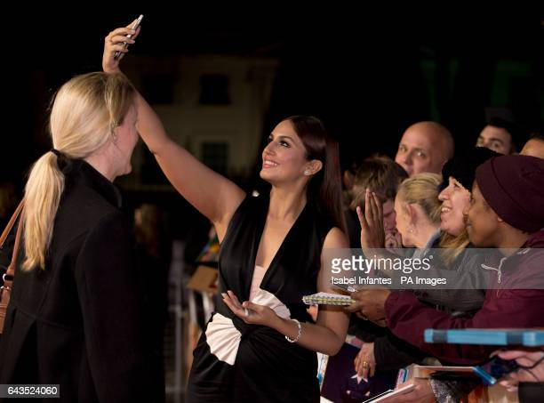 Huma Qureshi takes selfies with fans at the Viceroy's House UK Premiere at the Curzon Mayfair Cinema London