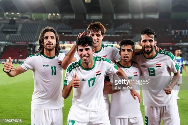 Humam Tareq Faraj Alaa Ali Mhawi Mohanad Ali Kadhim Ali Faez Atiyah and Bashar Resan Bonyan of Iraq celebrates the victory with fans after the AFC...