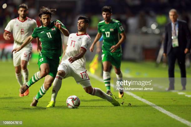 Humam Tareq Faraj of Iraq and Mehdi Taremi of Iran in action during the AFC Asian Cup Group D match between Iran and Iraq at Al Maktoum Stadium on...