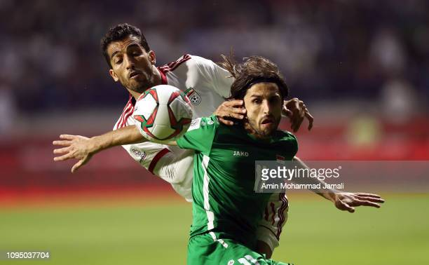 Humam Tareq Faraj of Iraq and Vahid Amiri of Iran in action during the AFC Asian Cup Group D match between Iran and Iraq at Al Maktoum Stadium on...