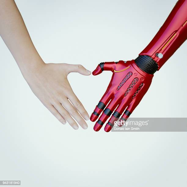 Human and cyborg heart shape hands