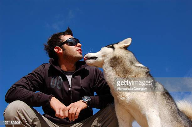 human and husky dog - inuit stock pictures, royalty-free photos & images