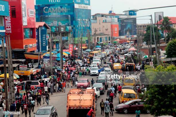 Human and vehicular traffic build up along Awolowo Way, Ikeja, Lagos on Wednesday, May 13 2020. In order to cushion the hardship of Coronavirus...
