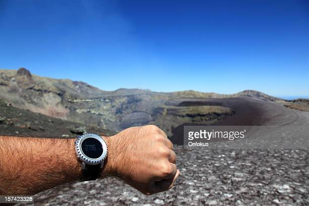 human arm showing altimeter at villarrica volcano summit - villarrica stock photos and pictures