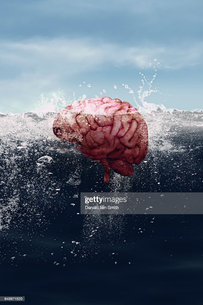 Human Brain Floating In The Sea Parts Visible Above And