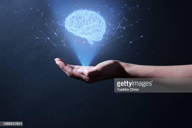 human brain hologram - cerveau humain photos et images de collection