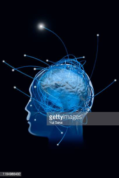 human brain make it tense by fiber optics - nucleus stock pictures, royalty-free photos & images