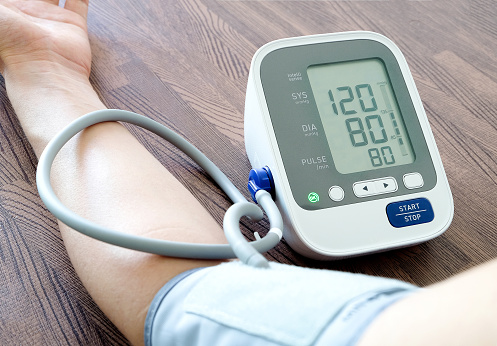 Human check blood pressure monitor and heart rate monitor with digital pressure gauge. Health care and  Medical concept 926093506