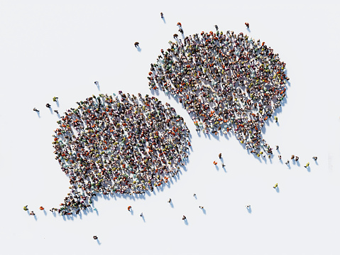 Human Crowd Forming A Big Speech Bubble: Communication And Social Media Concept 866608444