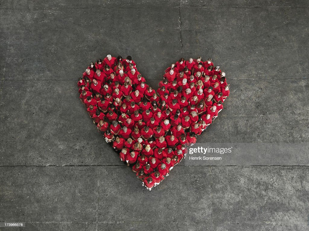 Human crowd, forming a heart : Stock Photo