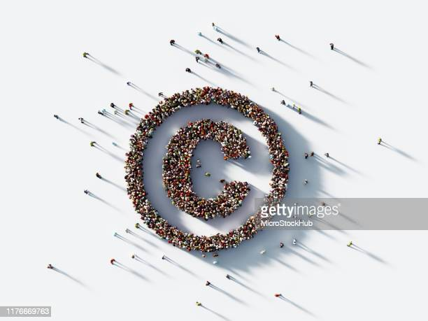 human crowd forming copyright symbol on white background : patent and copyright concept - intellectual property stock pictures, royalty-free photos & images