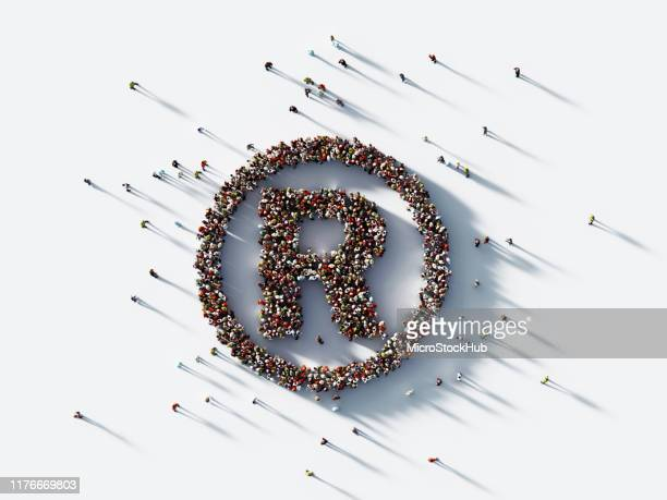 human crowd forming registered trademark symbol on white background : patent and copyright concept - intellectual property stock pictures, royalty-free photos & images
