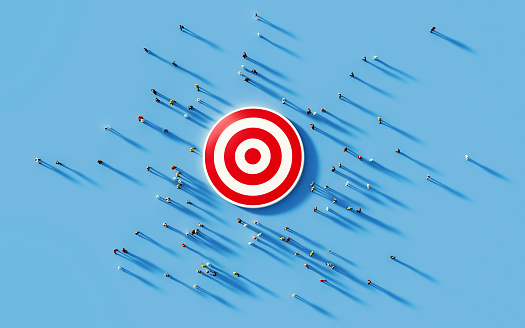 Human Crowd Gathering Around A Red Bulls Eye: Marketing and Target Audience Concept 1168415221