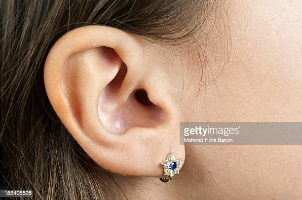 human ear - earring stock pictures, royalty-free photos & images