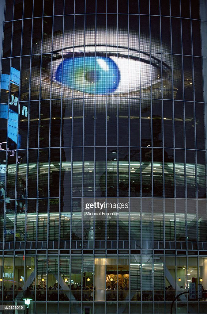 Human Eye Looking Down on an Office, Digital Composite : Stock Photo