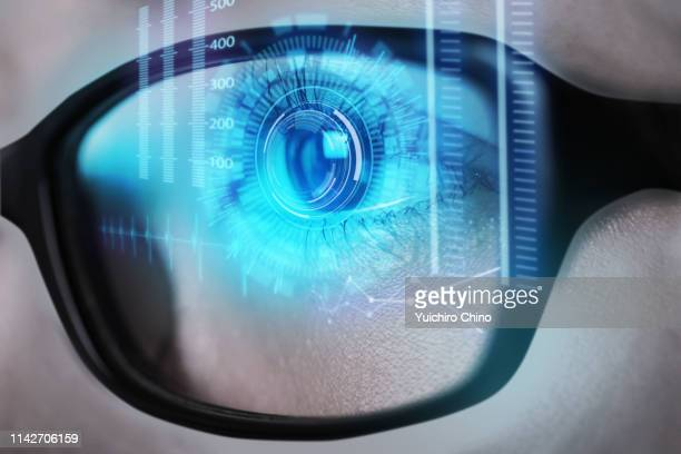 human eye test with technology - hud graphical user interface stock photos and pictures