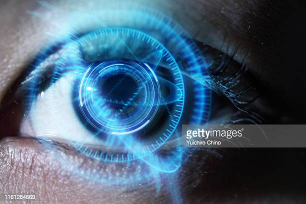 human eye with using the futuristic technology - hud graphical user interface fotografías e imágenes de stock