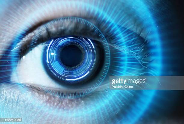 human eye with using the futuristic technology - digital composite stock-fotos und bilder