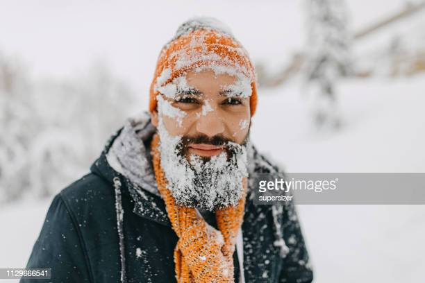 human face covered with snow - santa face stock pictures, royalty-free photos & images