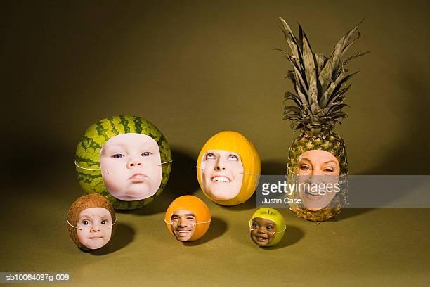 human faces on fruits (digital composite) - frau gefesselt stock-fotos und bilder