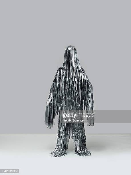 human figure created by christmas tinsel - tinsel stock pictures, royalty-free photos & images