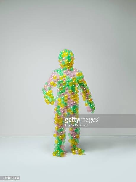 human figure created by colored toy balls