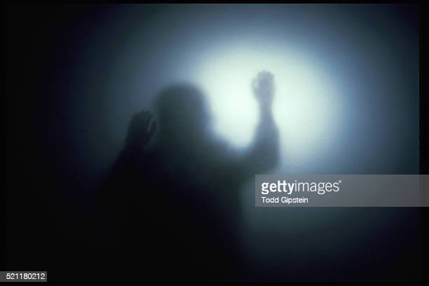 human figure silhouetted by ethereal light - gipstein stock pictures, royalty-free photos & images