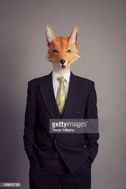 A human figure with a fox head wearing a suit