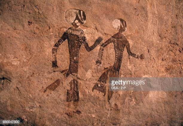 Human figures with bodily ornaments and zoomorphic figures petroglyphs of Tassili n'Ajjer Sahara Algeria