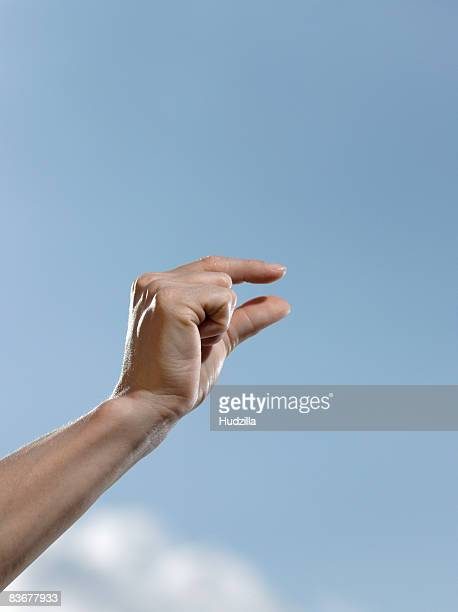 Human fingers making a measuring gesture