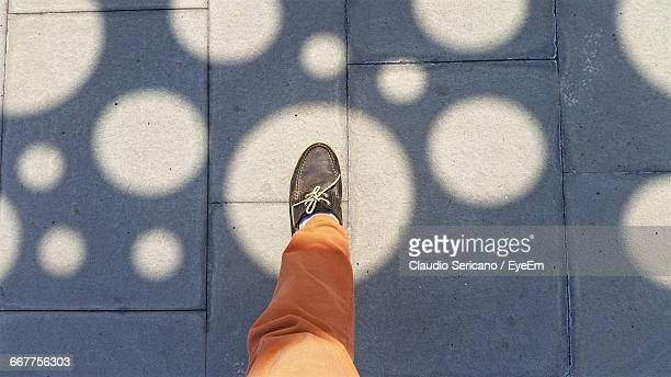human foot in spot light against sunlight - showing off stock pictures, royalty-free photos & images