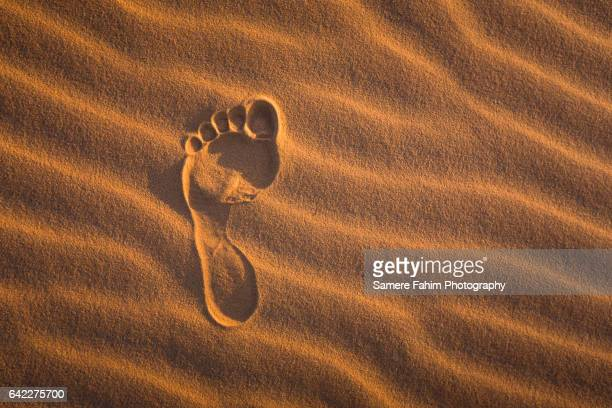 Human footprint On Corrugated Sand