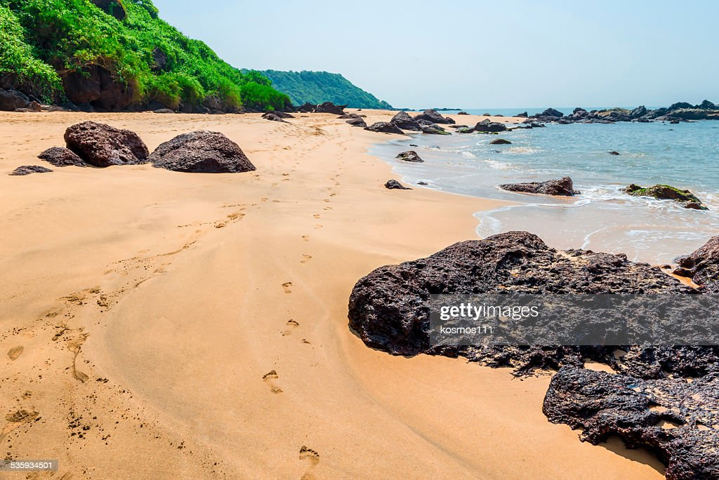 Human footprints on a sandy beach on the island : Stock Photo