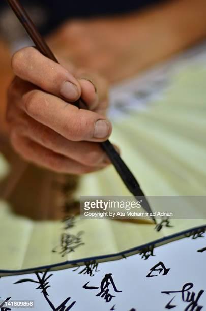 Human hand doing calligraphy