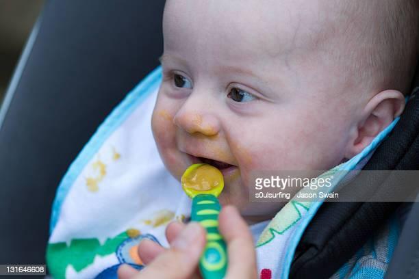 human hand feeding small baby - s0ulsurfing stock-fotos und bilder