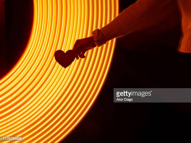 human hand holding a heart in a virtual environment. - love stock pictures, royalty-free photos & images